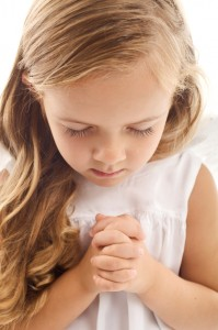 Little girl praying - closeup