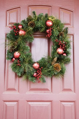 Christmas wreath hanging on door.